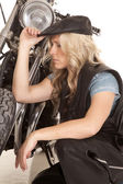 Woman leather hat kneel by motorcycle look side — Stock Photo