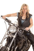 Woman leather vest sit on motorcycle look serious — Stock Photo