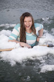 Gilr in ice hold with axe laughing — Stock Photo