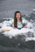 Girl in ice hole scared — Stock Photo