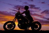 Silhouette woman motorcycle sit elbow on tank — Stock Photo