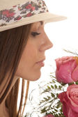 Woman hat close smell roses — Stock Photo