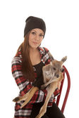 Woman in beanie and plaid shirt baby kangaroo look — Stock Photo