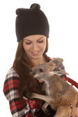 Woman in beanie and plaid shirt baby kangaroo look down — Stock Photo