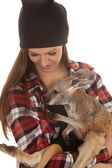 Woman in beanie and plaid shirt baby kangaroo — Zdjęcie stockowe