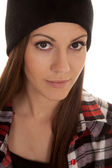 Woman in beanie and plaid shirt close look smile — Stock Photo
