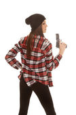 Woman in beanie and plaid shirt gun up side — Stock Photo
