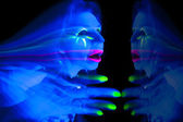 Woman black light ghost hand up — Stock Photo