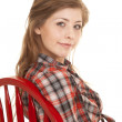 Постер, плакат: Cowgirl plaid shirt red chair close