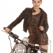 Stock Photo: Womleopard dress jacket stand on motorcycle look