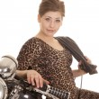 Stock Photo: Womleopard dress motorcycle sit side look