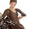 Stock Photo: Womleopard dress motorcycle sit sit smile jacket over shoulde