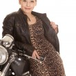 Stock Photo: Womleopard print dress leon motorcycle smile