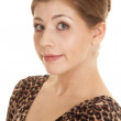 Woman leopard print dress sit close small smile — Stock Photo #41416261