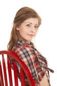 Cowgirl plaid shirt red chair close — Zdjęcie stockowe