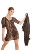Woman leopard dress hold out jacket — Zdjęcie stockowe