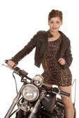 Woman leopard dress jacket stand on motorcycle look — Stock Photo