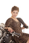 Woman leopard dress motorcycle sit side look — Stock Photo