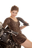Woman leopard dress motorcycle sit sit smile jacket over shoulde — Stock Photo