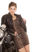 Woman leopard print dress lean on motorcycle smile — Stock Photo