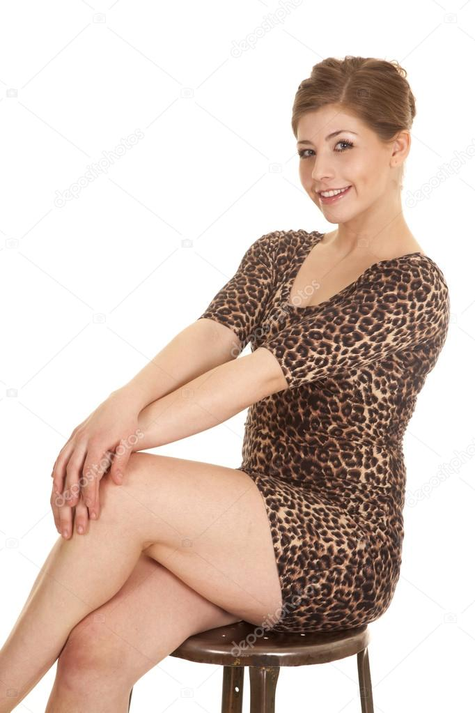 Woman Leopard Dress Cross Legs Hands Knees Stock Photo