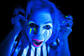 Woman black light scary — Stock Photo