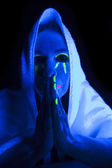 Woman black light towel pray — Stock Photo