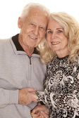 Elderly couple heads close hold hands — Stock Photo
