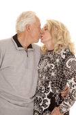 Elderly couple close kiss — Stock Photo