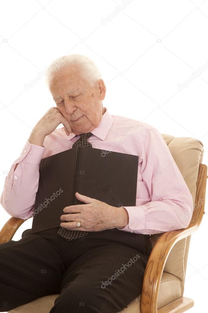 Elderly man pink shirt book sleep — Stock Photo © alanpoulson ...