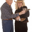 Elderly couple western holding kangaroo — Stock Photo