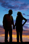 Silhouette elderly couple holding hands walk — Stock Photo
