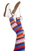 Legs colorful pattern white boots both up — Stock Photo
