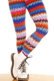 Legs colorful pattern white boots stand one toe — Zdjęcie stockowe
