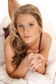Woman nightgown lay on stomach look serious — Foto Stock