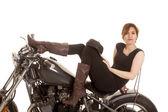 Latin woman sit motorcycle serious legs up — Stock Photo
