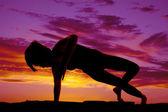 Woman dance silhouette one arm down — Photo