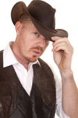 Cowboy close vest hand on hat serious — Stock Photo