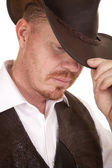 Cowboy close vest hat look down touch hat — Stock Photo