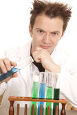 Mad scientist hold blue test tube — Stock Photo