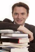 Man suit books close looking — ストック写真