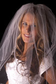 Woman bride veil on black close smile — Stock Photo