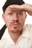 Man bandana hand on brow looking — Stock Photo