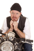 Man bandana motorcycle hands under chin — Stock Photo