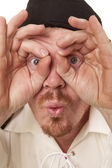 Man close look through hands wide eyes — Stock Photo