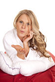 Woman white robe red sheet lay blow kiss — Stock Photo