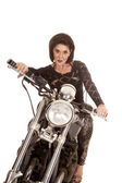 Older woman on motorcycle serious — Stock Photo