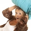 Woman in robe blue pillow over head — Stock Photo