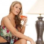 Woman sit by lamp — Stock Photo