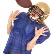 Woman football player hit in helmet with ball — Stock Photo #42631887